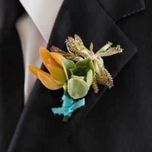 orange green blue succulent boutonniere