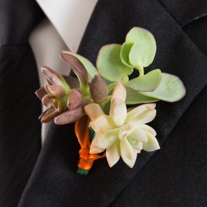red green pink succulent boutonniere wedding