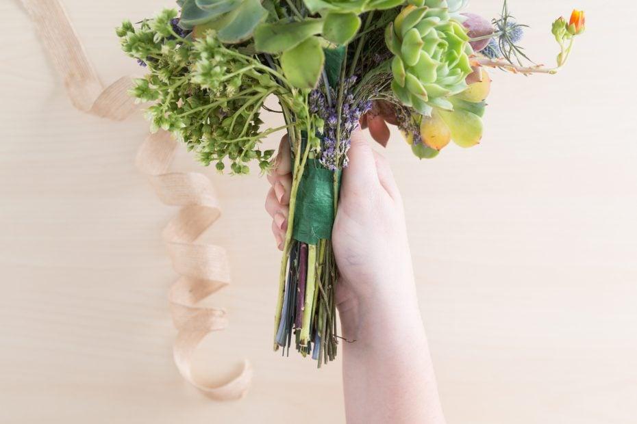 remove ribbon around floral succulent bouquet handle to disassemble for arrangement