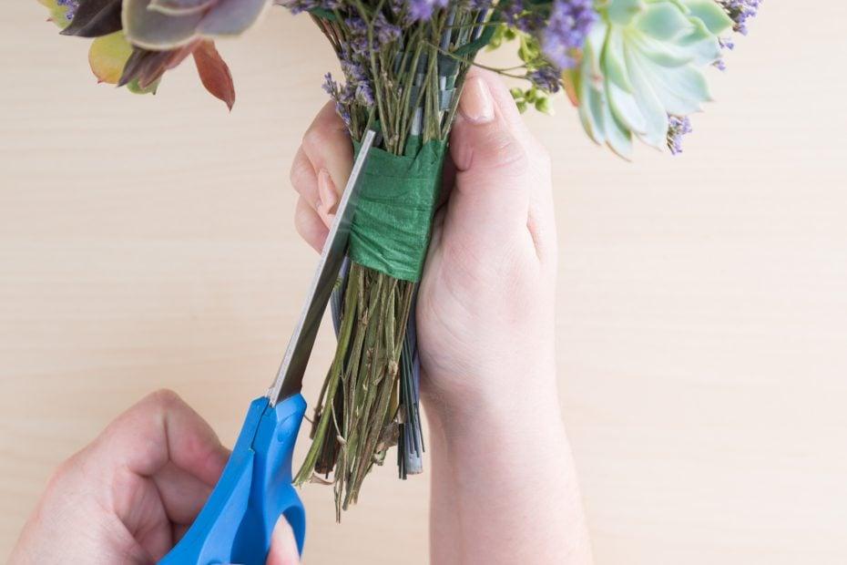 cut tape off of bouquet to save succulents for arrangement