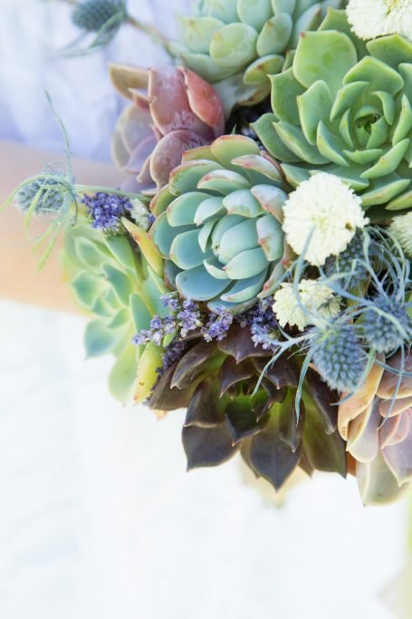 close up bridal wedding bouquet with succulents