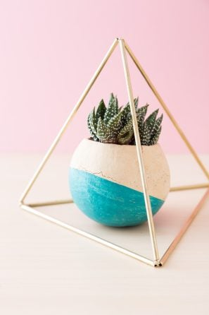 himmeli pyramid around succulent in painted bell cup