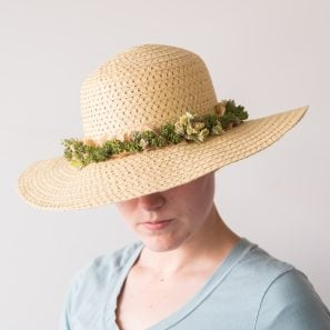 straw hat with live succulents along ribbon band