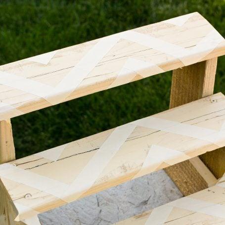 use masking tape to mark of design on wood plant riser